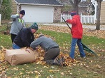 scouts raking leaves